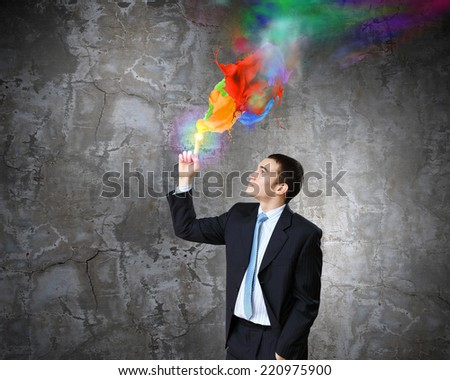 Young businessman in suit and colorful splashes