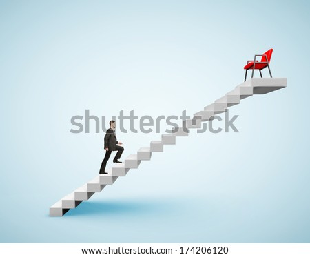 young businessman in suit climbing to chair - stock photo