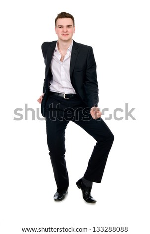 Young businessman in suit dancing. Isolated on white background - stock photo