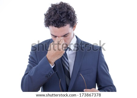 young businessman in suit having hard headache
