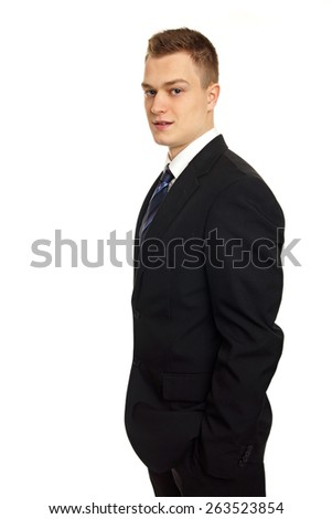 Young businessman in suit, left you can write some text - stock photo