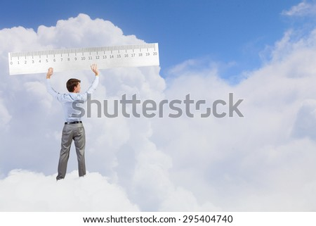 Young businessman in suit measuring ruler benefit