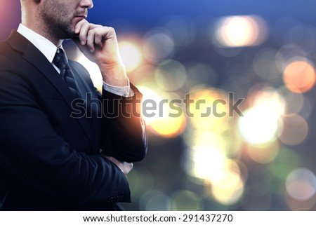 young businessman in suit on blured color background - stock photo