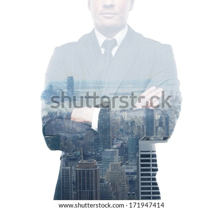 young businessman in suit standing on city background - stock photo