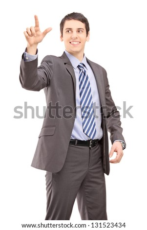 Young businessman in suit touching something imaginery isolated on white background - stock photo