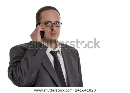 Young Businessman in suit with cellphone isolated on white background