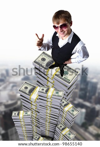 Young businessman in sun glasses with money - stock photo