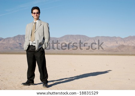 Young businessman in the desert