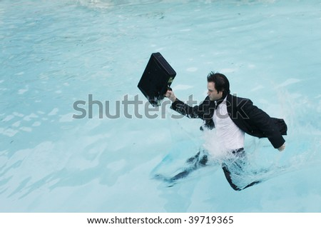 Young businessman in the water.