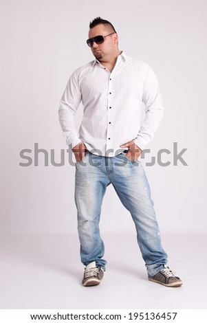Young businessman in white shirt standing and thinking