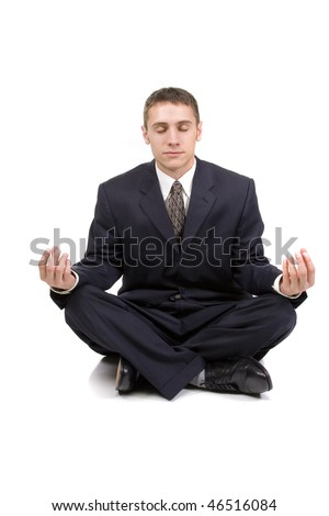 Young businessman in yoga position on white