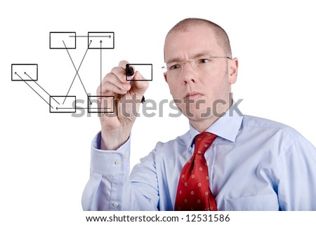 Young businessman is drawing some graphics. Full isolated studio picture - stock photo