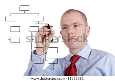 Young businessman is drawing some graphics. Full isolated studio picture. Focus is on the graphic. - stock photo
