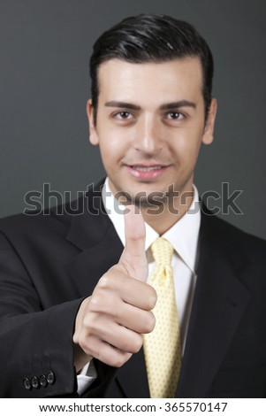 "Young businessman is giving an ""OK"" sign with confidence."