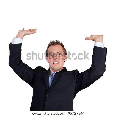 young businessman isolated on a white background holding something