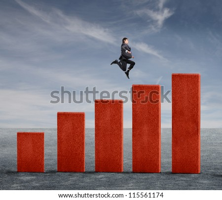 Young businessman jumping on a business analysis - stock photo