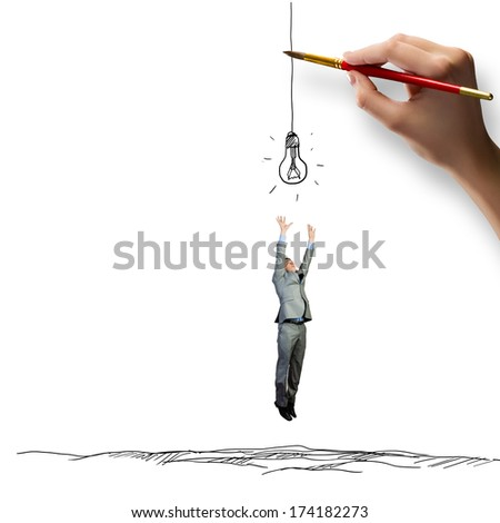 Young businessman jumping to catch drawn bulb. Idea concept