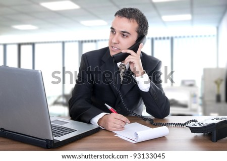 young businessman latino in office - stock photo