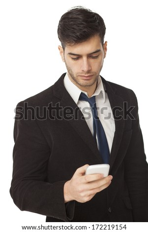 Young businessman looking at his PDA - stock photo