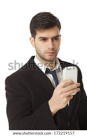Young businessman looking at his PDA