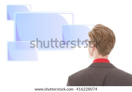 Young businessman looking at light blue frames isolated on white background - stock photo