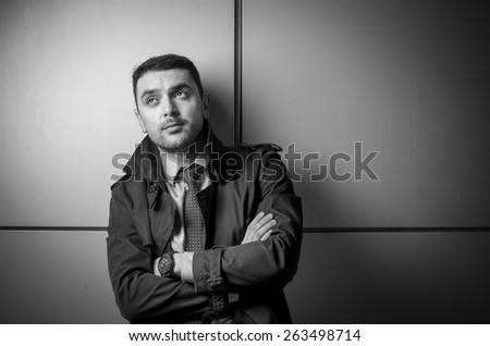 Young businessman low key portrait - stock photo