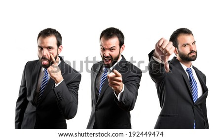 Young businessman making a mockery, a bad sign, and shouting - stock photo