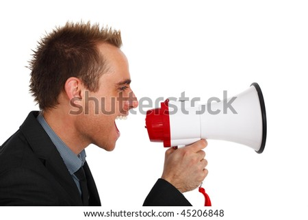 young businessman making an announcement with a megaphone - stock photo