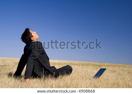 young businessman making peace with nature - stock photo