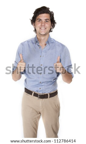 Young businessman making thumbs up sign