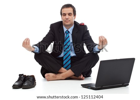 Young businessman meditating - stress control concept