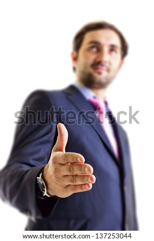 Young businessman offering his hand,isolated on white - stock photo