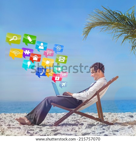 Young businessman on his beach chair using his laptop with colourful computer applications - stock photo