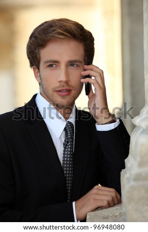 Young businessman on phone - stock photo