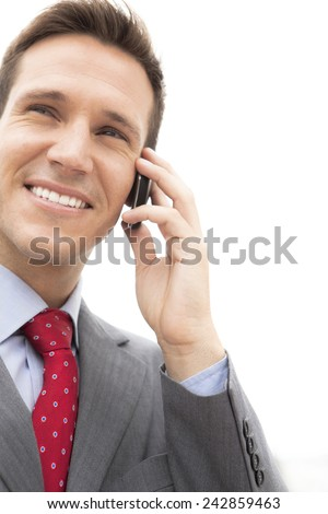 Young businessman on the phone - Close-up isolated on white