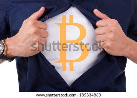 Young businessman opening his shirt and showing bitcoin currency symbol - stock photo