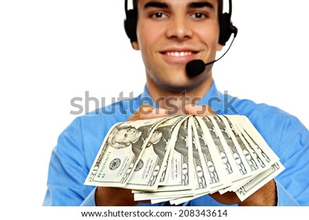 Young businessman operator shows you money  - stock photo