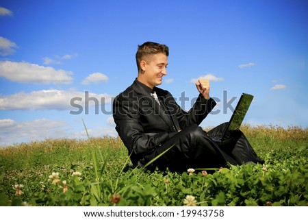 Young businessman outdoor with using laptop.