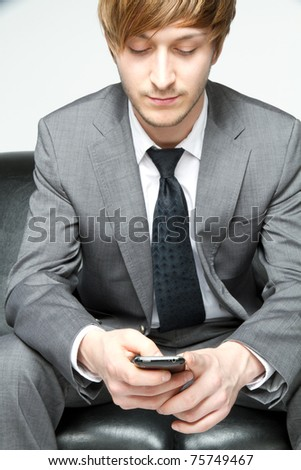 young businessman playing with his cell - stock photo