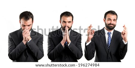 Young businessman pleading over white background  - stock photo