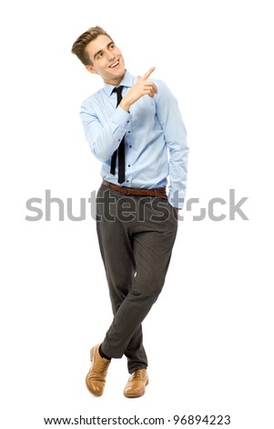 Young businessman pointing - stock photo