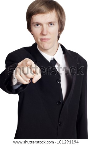 Young businessman pointing at you - stock photo