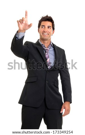 Young businessman pointing isolated in white