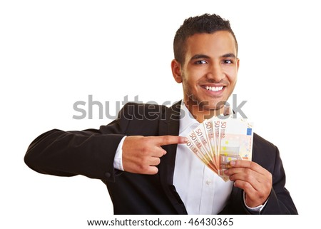 Young businessman pointing to many European banknotes