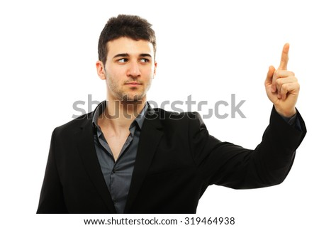 Young businessman pointing with his left hand, isolated on white