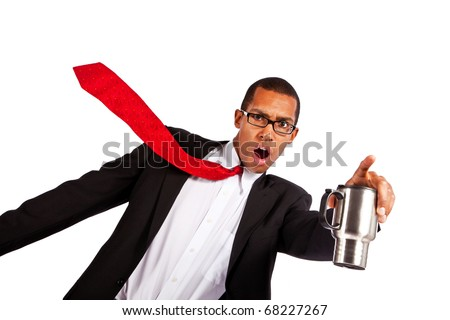 Young businessman points while holding coffee mug. - stock photo