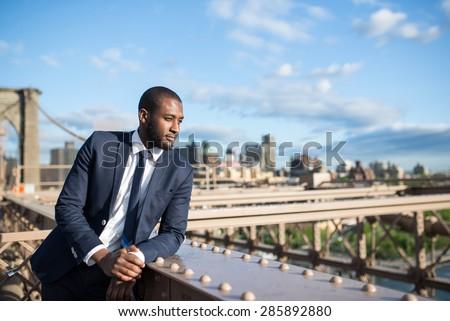 Young businessman portrait on Brooklyn Bridge. New York City. - stock photo