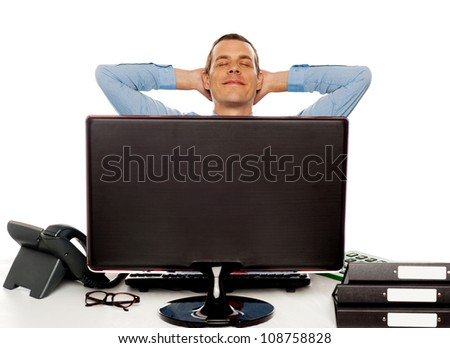 Young businessman posing in a relaxed manner with hands behind head - stock photo
