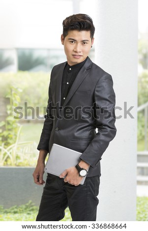 Young businessman posing with digital tablet. - stock photo