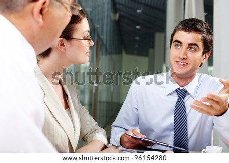 Young businessman presenting a new promising project to his colleagues - stock photo